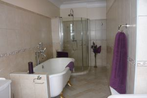 Castle En suite bathrooms , shower cubical and bath
